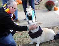 Rev. Jeffrey A. Wargo (left) blesses a dog named Vixen during a blessing of pets ceremony Sunday, October 23, 2016 at St. Stephen's United Church of Christ in Perkasie, Pennsylvania. (Photo by William Thomas Cain)