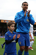 AFC Wimbledon striker Kweshi Appiah (9), mascot during the EFL Sky Bet League 1 match between AFC Wimbledon and Luton Town at the Cherry Red Records Stadium, Kingston, England on 27 October 2018.
