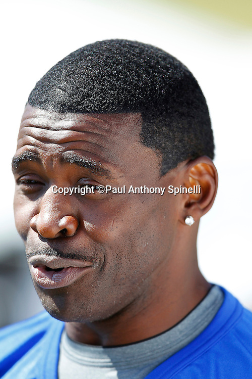 Former Dallas Cowboys wide receiver Michael Irvin (88) of the Famers team smiles during a media interview as he gets ready to play flag football in the EA Sports Madden NFL 11 Launch celebrity and NFL player flag football game held at Malibu Bluffs State Park on July 22, 2010 in Malibu, California. (©Paul Anthony Spinelli)