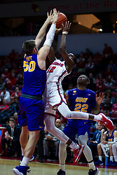 NORMAL, IL - December 31: Antonio Reeves shoots over Austin Phyfe sandwiched between Antwan Kimmons during a college basketball game between the ISU Redbirds and the University of Northern Iowa Panthers on December 31 2019 at Redbird Arena in Normal, IL. (Photo by Alan Look)