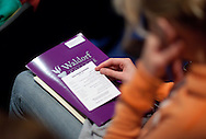 A prospective student looks at her schedule during an open house at Waldorf College in Forest City, Iowa on Saturday, May 14, 2011.