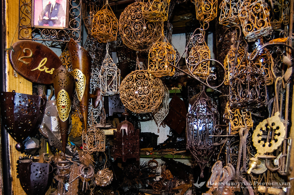 Morocco, Marrakesh. Metal wares for sale in the souk just north of Djemaa El Fna.