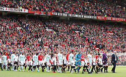 Manchester United Legends manager Sir Alex Ferguson (far right) leads the team out for the legends match at Old Trafford, Manchester.