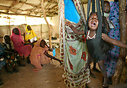 A sick Sudanese IDP (Internally displaced people) child is weighed at the MSF (Medicines Sans Fronteir) clinic in the  Al Hameidia IDP camp, home to more than 20 000 displaced Sudanese near the town of Zelingei in West Darfur, Sudan Monday 18 October 2004.<br /> <br /> The MSF clinic reports approximately 300 new cases of Malaria each week and around 100 new cases of Jaundice. Chronic dioreah and respiratory problems are also prevelant as well as 10% of the IDP's suffering from various stages of Malnutrition.<br /> <br /> African leaders at the recent summit on Darfur in Libya suggested autonomy and a federal system of government for the Darfur region as a possible solution to the crisis which has seen more than 1.5 million displaced.<br /> <br /> EPA PHOTO/NIC BOTHMA