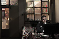 Xiangyuan (Shanxi) January 24, 2012<br />Li Ke a prolific author of online novels, in his room where he spends hours every day writing. Li runs a double life: policeman during the day and writer when he is not on duty.