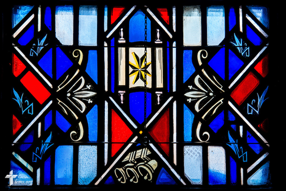 Stained glass at Luther Memorial Chapel depicting a scroll and ringing bells on Friday, Jan. 29, 2016, in Shorewood, Wis. LCMS Communications/Erik M. Lunsford