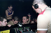 Clubbers surrounding DJ Judge Jules in DJ booth, Club Class, Ikon, Maidstone, Kent, 2002
