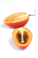 Close up of tamarillo on white background