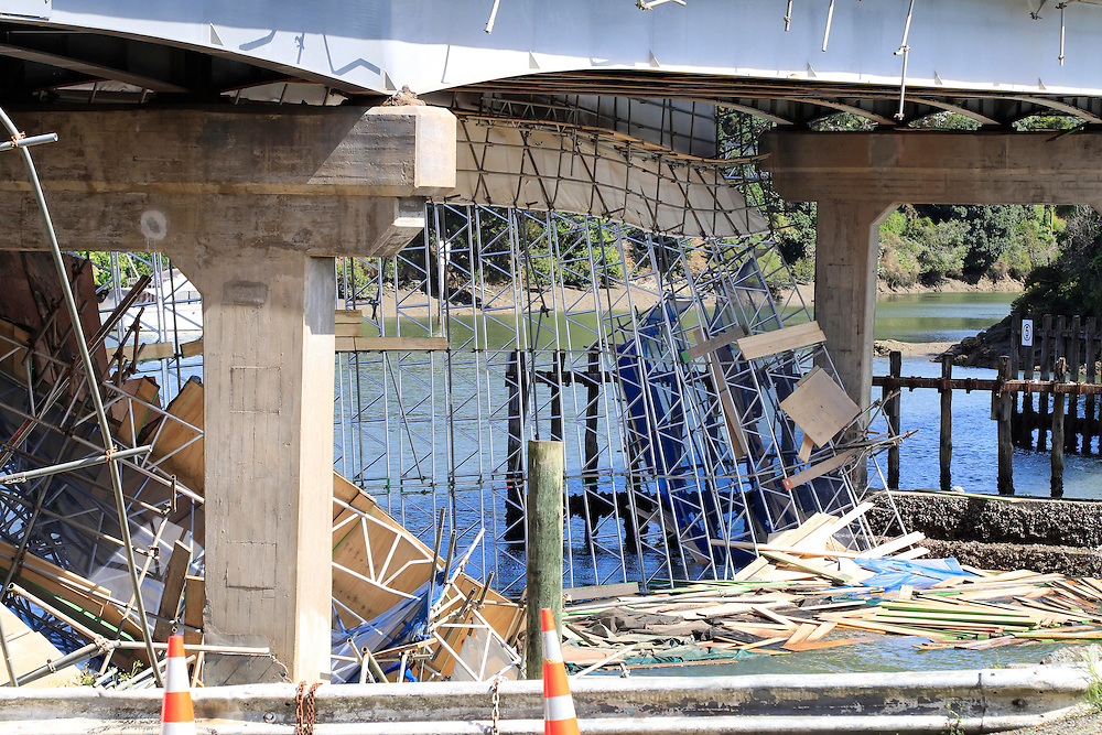 A workman has been rescued uninjured amongst scaffolding and six other workman have been taken from the Panmure River after scaffolding on the Panmure Road Bridge collapsed, Auckland, New Zealand, Tuesday, February 21, 2017. Credit:SNPA / Hayden Woodward **NO ARCHIVING**