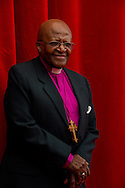 South African Archbishop and Nobel peace laureate Desmond Tutu poses as he arrives for a photocall for the documentary 'Children of the Light' as part of the 54st Monte-Carlo Television Festival on June 8, 2014 in Monaco