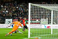 NIJMEGEN, NEC Nijmegen - SC Heerenveen, voetbal Eredivisie, seizoen 2013-2014, 25-10-2013, Stadion de Goffert, NEC speler Michael Higdon (R) scoort de 2-0, SC Heerenveen keeper Kristoffer Nordfeldt (M) en SC Heerenveen speler Pele van Aanholt (L) zijn te laat.