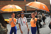Leandra Medine, The Man Repeller, is shaded from the hot summer sun by AccuWeather's MinuteCast street team at New York Fashion Week, on Saturday, Sept. 12, 2015. AccuWeather is at it again helping Fashion Week attendees stay stylish and one-step ahead of any possible precipitation. (Photo by Diane Bondareff/Invision for AccuWeather/AP Images)