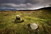 "The first monument before you reach Meini Hirion, (meaning long stones) which are known in English as Druid's Circle.<br /> <br /> This is a prehistoric monument on the hilltop above Penmaenmawr, North Wales. A 1958-9 excavation revealed two three sided cists, (stone slabs placed on end forming a cavity). Each contained a cremation burial, which in one case was sealed by a layer of quartz pebbles. Other finds within this ""disturbed circle"" were an oval hearth on which flat stones had been placed as if to extinguish the fire; a circular fire pit full of charcoal and a Graiglwyd stone axe. The site has been dated as being as being 1130-145 B.C."