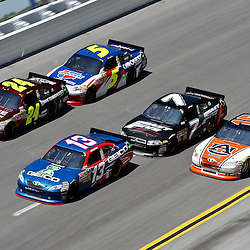 April 17, 2011; Talladega, AL, USA; NASCAR Sprint Cup Series driver Casey Mears (13) leads Jeff Gordon (24), Mark Martin (5), Robby Gordon (7) and Michael Waltrip (15) as they go three wide in turn four during the Aarons 499 at Talladega Superspeedway.   Mandatory Credit: Derick E. Hingle