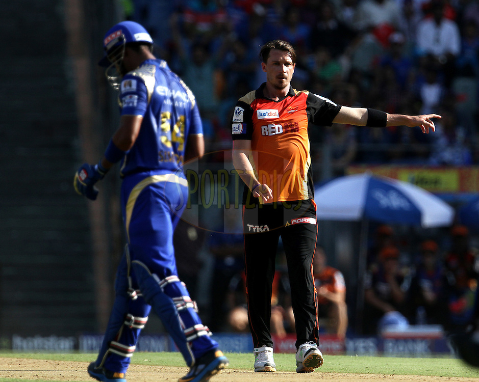 Sunrisers Hyderabad player Dale Steyn celebrates the wicket of Mumbai Indians player Lendl Simmons during match 23 of the Pepsi IPL 2015 (Indian Premier League) between The Mumbai Indians and The Sunrisers Hyderabad held at the Wankhede Stadium in Mumbai India on the 25th April 2015.<br /> <br /> Photo by:  Vipin Pawar / SPORTZPICS / IPL