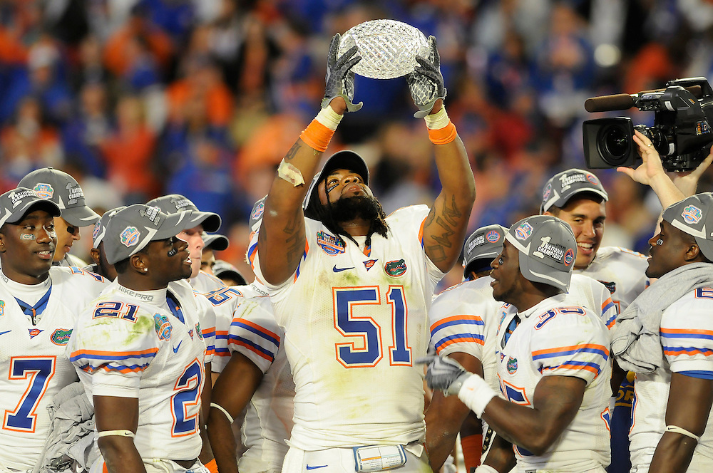 January 8, 2009: Brandon Spikes of the Florida Gators holds up the national championship trophy after the NCAA football game between the Florida Gators and the Oklahoma Sooners in the 2009 BCS National Championship Game. The Gators defeated the Sooners 24-14.
