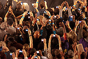 "Boston- The audience holds up cameras and camera phones when President Barack Obama is speaking on stage. ""This is the first time I have seen Obama,"" said 85-year-old Robert Nobel, not pictured. He said he has seen every president speak since President Franklin D. Roosevelt. (Photo/Rachel Larue/COM 2011)"