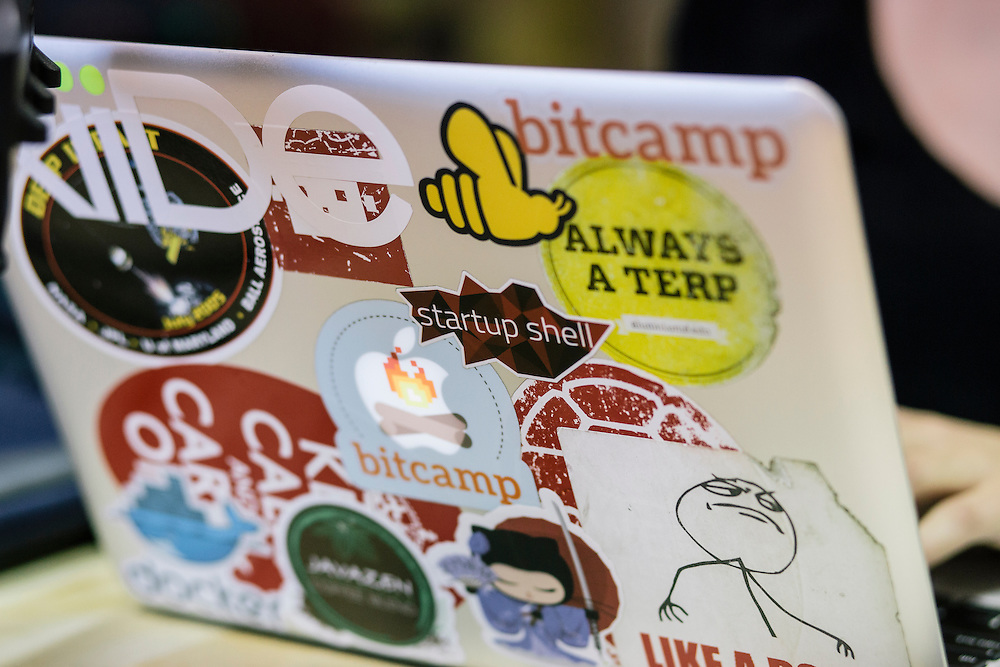 University of Maryland senior and director of Startup Shell, Mackenzie Burnett's computer is adorned with various stickers including bitcamp, UMD's hackathon, at the Startup Shell headquarters on the University of Maryland campus on April 1, 2015. Startup Shell is a not for profit company run entirely by and for students at UMD. Entrepreneurial students from all different disciplines apply to join and if accepted, can work on their innovative project with others collaborating and learning from one another.