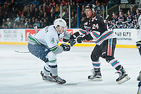 KELOWNA, CANADA - NOVEMBER 25: Tyson Baillie #24 of Kelowna Rockets checks Turner Ottenbreit #4 of Seattle Thunderbirds during first period on November 25, 2015 at Prospera Place in Kelowna, British Columbia, Canada.  (Photo by Marissa Baecker/Getty Images)  *** Local Caption *** Tyson Baillie; Turner Ottenbreit;
