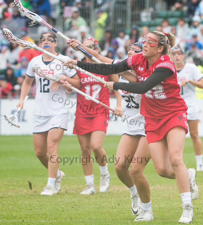Canada's Taylor Gait(22) and USA'a Marie McCool(25) battlle for possession at the 2017 FIL Rathbones Women's Lacrosse World Cup at Surrey Sports Park, Guilford, Surrey, UK, 15th July 2017