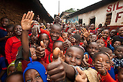 Nairobi, June 2010 -  As part of the oasis project which we were working on, we had asked the directors  at the Siloam children's home whether a few of the kids might pose for photo. The crowd grew as well as the excitement as the kids surged to get their photo taken.