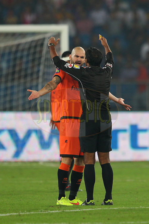 Hans Mulder of Delhi Dynamos FC has words with the referee during match 16 of the Hero Indian Super League between The Delhi Dynamos FC and NorthEast United FC held at the Jawaharlal Nehru Stadium, Delhi, India on the 29th October 2014.<br /> <br /> Photo by:  Ron Gaunt/ ISL/ SPORTZPICS