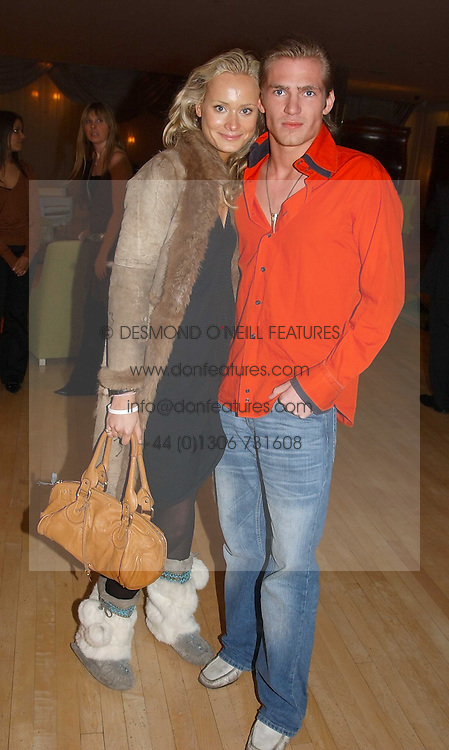 KALITA AL-SWAIDI and JACOBI ANSTRUTHER-GOUGH-CALTHORPE at the annual Laurent Perrier Pink Party held at The Sanderson Hotel, Berners Street, London on 27th April 2005.<br />