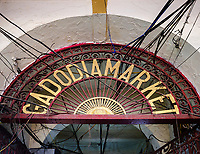NEW DELHI, INDIA - CIRCA NOVEMBER 2018: Entrance to the Gadodia Spice Market in Old Delhi. This market is full of stores and it is one the largest spice markets in Asia. It is located to the south of the famous Khari Baoli Street.
