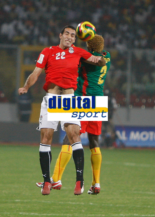 Photo: Steve Bond/Richard Lane Photography.<br />Egypt v Cameroun. Africa Cup of Nations. 22/01/2008. Mohamed Abo Terika (L) and Augustin Binya (R) in an aeriel battle