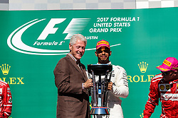 October 22, 2017 - Austin, Texas, U.S - Former President Bill Clinton and Mercedes driver Lewis Hamilton (44) of Great Britain on the podium after the Formula 1 United States Grand Prix race at the Circuit of the Americas race track in Austin,Texas. (Credit Image: © Dan Wozniak via ZUMA Wire)