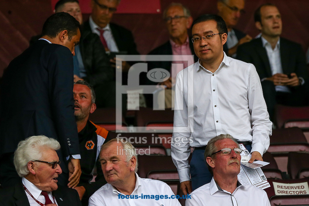 Jeff Shi, Fosun represenative on the Wolves board, (right) takes his seat before the pre-season match at Sixfields Stadium, Northampton<br /> Picture by Andy Kearns/Focus Images Ltd 0781 864 4264<br /> 26/07/2016