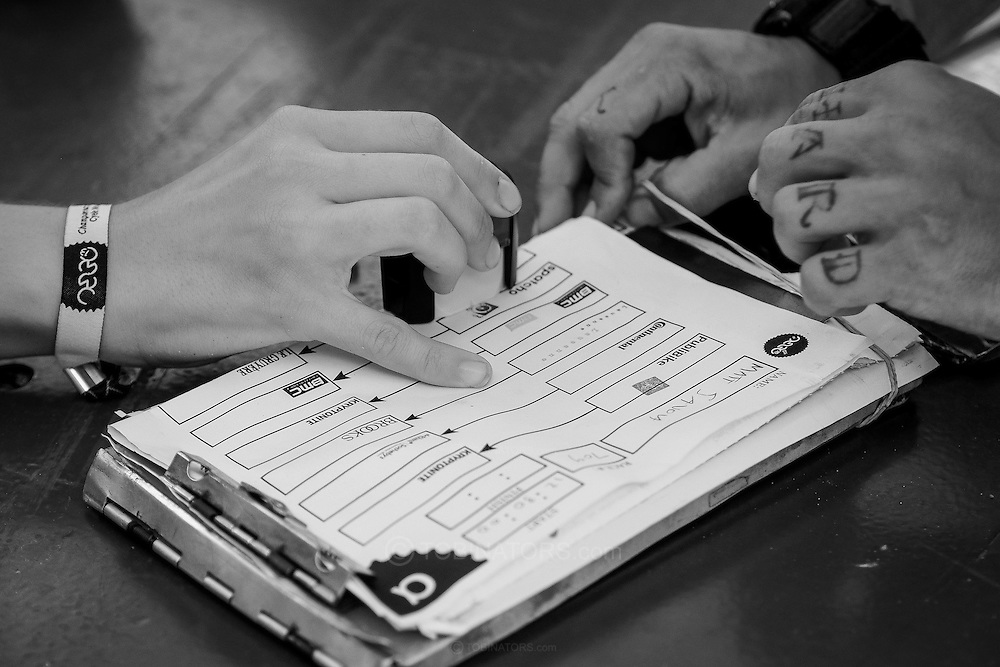 Picture by Andrew Tobin/Focus Images Ltd +44 7710 761829<br /> 05/08/2013<br /> A competitor's manifest is stamped at a checkpoint to prove they have delivered correctly during the Cycle Messenger World Championships held in Lausanne, Switzerland. Started in 1993 by Achim Beier from Berlin, the championships are not only a sporting contest but an opportunity to unite friends and bicycle enthusiasts worldwide. The event comprises a number of challenges including a sprint, a track stand (longest time stationary on the bike), a cargo race where heavy loads are carried on special bikes, and the main race. The course winds through central Lausanne and includes bridges, stairs, cobbles, narrow alleyways and challenging hills. The main race simulates the job of a bike courier making numerous drops and pickups across the city. Riders need to check in at specific checkpoints, hand over their delivery and get a new one. The main race can take up to 4 hours for each competitor to complete.