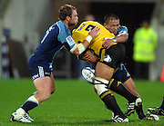 Hurricanes no 8 Victor Vito loses the ball in the tackle of Luke Braid and Keven Mealamu. Super 15 rugby match - Hurricanes v Blues at Westpac Stadium, Wellington, New Zealand on Friday, 30 April 2011. Photo: Dave Lintott / photosport.co.nz