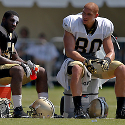 Jul 29, 2013; Metairie, LA, USA; New Orleans Saints outside linebacker Jonathan Vilma (51) and tight end Jimmy Graham (80) during a morning training camp practice at the team facility.  Mandatory Credit: Derick E. Hingle-USA TODAY Sports