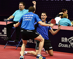 June 1, 2018 - Shenzhen, China - Ovidiu Ionescu (front L) of Romania and Alvaro Robles of Spain celebrate victory after defeating Ma Long and Xu Xin of China during the men's doubles semifinal at the 2018 Seamaster ITTF World Tour Platinum China Open in Shenzhen. (Credit Image: © Mao Siqian/Xinhua via ZUMA Wire)