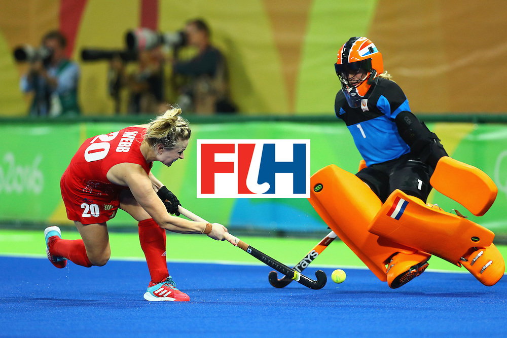 RIO DE JANEIRO, BRAZIL - AUGUST 19:  Hollie Webb of Great Britain scores the winning penalty past Joyce Sombroek of Netherlands during the Women's Gold Medal Match on Day 14 of the Rio 2016 Olympic Games at the Olympic Hockey Centre on August 19, 2016 in Rio de Janeiro, Brazil.  (Photo by Tom Pennington/Getty Images)