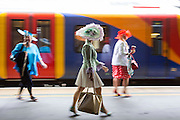 UNITED KINGDOM, London: 14 June 2016 Racegoers at Waterloo train station jump on a train heading to Royal Ascot for the first day of the annual horse racing event. Rick Findler / Story Picture Agency