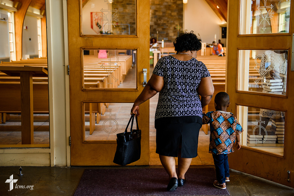 Families arrive for worship at Lamb of God Lutheran Church, housed in Ascension Lutheran Church, Landover Hills, Md., on Sunday, Aug. 6, 2017. LCMS Communications/Erik M. Lunsford