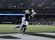 Dec 17, 2017; Oakland, CA, USA; Oakland Raiders wide receiver Michael Crabtree (15) hauls in a touchdown catch in front of Dallas Cowboys cornerback Chidobe Awuzie (33) during an NFL football game at Oakland-Alameda County Coliseum.