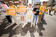 "29 JULY 2010 - PHOENIX, AZ: Unitarian Universalists from across the US block Washington Street in downtown Phoenix. Dozens of people were arrested during protests against SB 1070 across central Phoenix Thursday. US Judge Susan Bolton's ruling Wednesday stopped four of SB 1070's more than a dozen provisions from going into effect. She wrote, ""The court also finds that the United States is likely to suffer irreparable harm if the court does not preliminarily enjoin enforcement of these sections,"" she states in the ruling. ""The balance of equities tips in the United States' favor considering the public interest.""    PHOTO BY JACK KURTZ"
