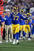 Los Angeles Rams offensive tackle Andrew Whitworth (77) waves his arms as he questions an officials call during an NFL divisional football playoff game against the Dallas Cowboys in Los Angeles, Saturday, Jan. 12, 2019. The Rams won the game 30-22. (©Paul Anthony Spinelli)