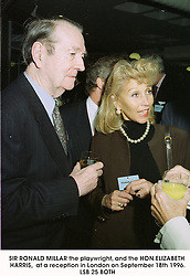 SIR RONALD MILLAR the playwright, and the HON.ELIZABETH HARRIS,  at a reception in London on September 18th 1996.LSB 25 BOTH