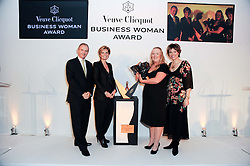 Left to right, GRAHAM BOYES, SABINA BELLI, GILL RILEY and KATE SILVERTON at the presentation of the Veuve Clicquot Business Woman Award 2010 held at the Institute of Contemporary Arts, 12 Carlton House Terrace, London on 23rd March 2010.  The winner was Laura Tenison - Founder and Managing Director of JoJo Maman Bebe.