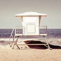 California lifeguard tower retro panoramic picture. Panoramic photo ratio is 1:3. The lifeguard tower is located in Huntington Beach in Orange County Southern California.