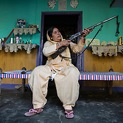 UTTAR PRADESH, INDIA - OCTOBER, 25, 2016: Shahana Begum, 42, mother of four children, who keeps her community safe with her gun in hand is pictured inside her residence at Mahanandpur, a village in Uttar Pradesh, India.<br />