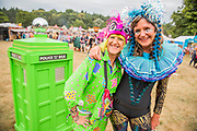 Henham Park, Suffolk, 19 July 2019. The founder of Retro Bambi and another stall holder enjoy selling vintage and other clothing - The 2019 Latitude Festival.