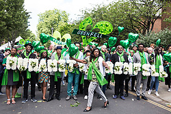London, UK. 14th June, 2018. Members of the local community, faith leaders, politicians and wellwishers take part in a silent procession from St Helen's Church to the Wall of Truth to mark the first anniversary of the Grenfell Tower Fire.