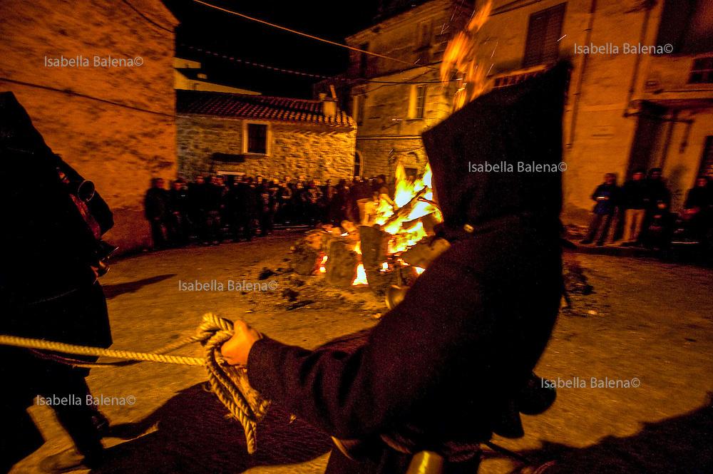 Sardegna, Italy. Orotelli (NU). Festa di Sant'Antonio abate. I thurpos attorno al fuoco.
