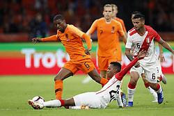 (L-R) Georginio Wijnaldum of Holland, Nilson Loyola of Peru during the International friendly match match between The Netherlands and Peru at the Johan Cruijff Arena on September 06, 2018 in Amsterdam, The Netherlands