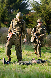 Reenactors portraying US Airborne troops check that German troops are dead during a small scale Skirmish at the Northallerton Wartime weekend charity fundraiser for Help for Heros and Ben Hyde Memorial Trust 9th &10th Ocober 2010 .Images<br />